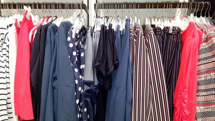 Clothing women dresses on hanger at modern shop boutique
