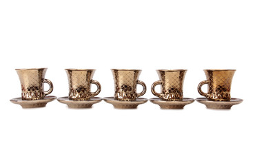 Ancient porcelain tea cups on a white background