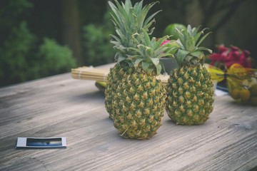 Pineapples on the wooden table. Fruit concept.