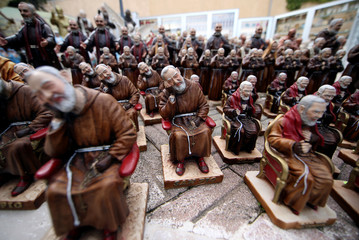 Statues depicting Saint Pio of Pietrelcina (Padre Pio) are seen outside a shop in San Giovanni Rotondo