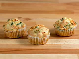 Freshly baked savoury muffins with cheddar, spinach and bell pepper