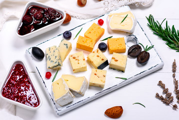 pieces of camembert cheese, roquefort, cheddar and brie