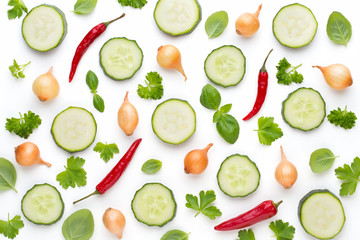 Vegetable and spices isolated on white background, top view. Wallpaper abstract composition of vegetables.
