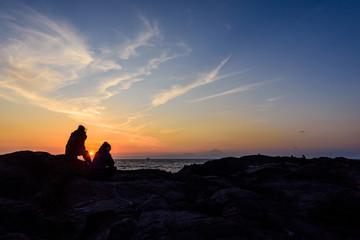 夕焼けと人影 The evening sky