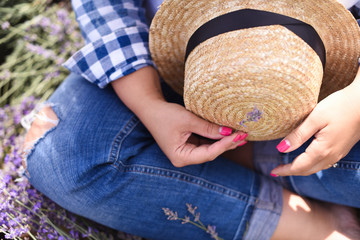 A woman in a straw hat in a lavender field