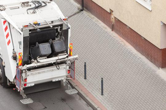 Garbage dustcart truck on city street