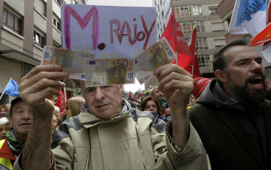 A man attends a demonstration demanding higher state pensions in Gijon