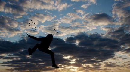 Men jump action on sunset area siluate style.