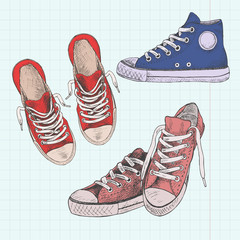Set of colored sneakers. Hand drawn illustration. Gumshoes on a background of a sheet of paper