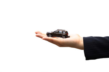 Businesswoman or saleswoman holding miniature car model, auto business, car trading, loans for car concept