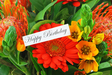 Happy birthday card with colorful flowers as background