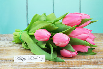 Happy birthday card with bunch of pink tulips