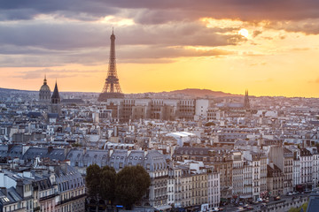 View of Paris with Eiffel tower silhouette at sunset