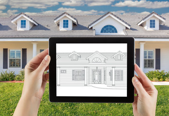 Female Hands Holding Computer Tablet with House Drawing on Screen, Photo Behind.