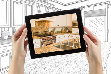 Female Hands Holding Computer Tablet with Kitchen on Screen & Drawing Behind.