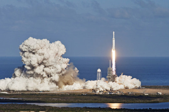 Rocket launch with moon on background. Elements of this image furnished by NASA