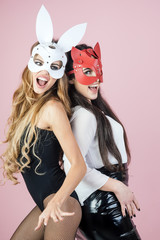 Sexy women with long hair in carnival masks, lgbt.