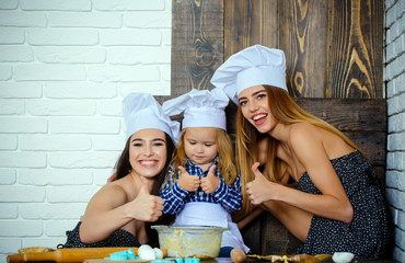 Boy and girls in chef hats giving thumbs up
