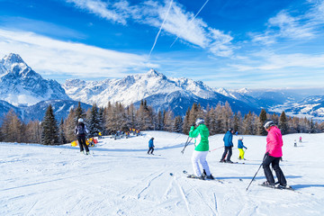 Skiing and snowboarding in high mountains, with Trentino Alto Adige's peaks in the background, San Candido. Italy