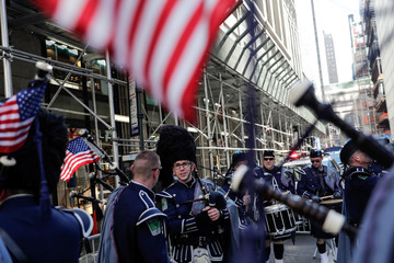 A bagpipe band wait to march the St Patrick's Day parade in New York City