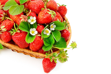 Appetizing strawberries in a wicker basket isolated on white background. Free space for text.