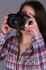 sensual, big-breast photographer woman with camera, take a picture with a photo camera