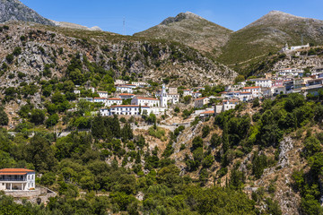 """Scenic Dhermi mountain village with school building (in albanian language """"shkolla"""") church and houses, Albania"""
