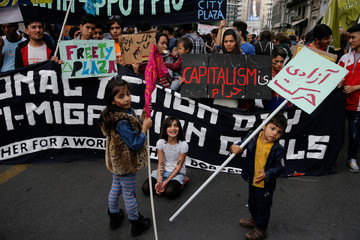 Children take part in a demonstration to mark United Nations day against racism in Athens