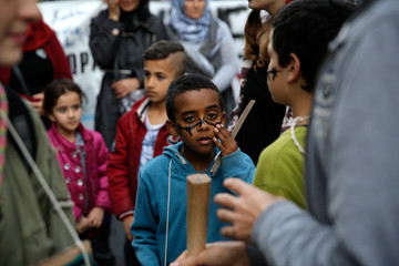 A child takes part in a demonstration to mark United Nations day against racism in Athens