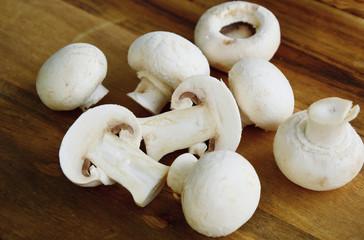 Agaricus bisporus or portobello mushroom on wooden floor