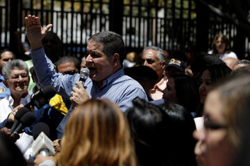 Luis Florido, lawmaker of the Venezuelan coalition of opposition parties (MUD), speaks during a gathering with opposition supporters in Caracas
