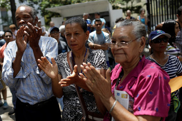 People attend a gathering of opposition supporters in Caracas