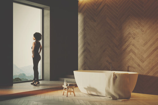 Wooden bathroom interior, white tub side toned