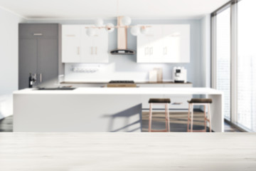 White kitchen, gray counters, table blur