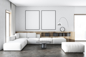 White brick living room, white sofa, posters