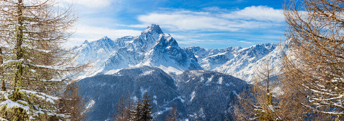 Panoramic image of the Dolomiti peaks in the  beautiful Winter time of the year, seen from Mont'Elmo, San Candido, Italy