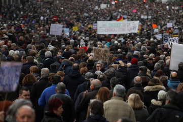 People take part in a demonstration demanding higher state pensions, in Madrid