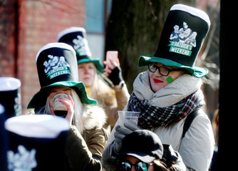 People attend St. Patrick's Day celebrations at Uzupis neighborhood in Vilnius