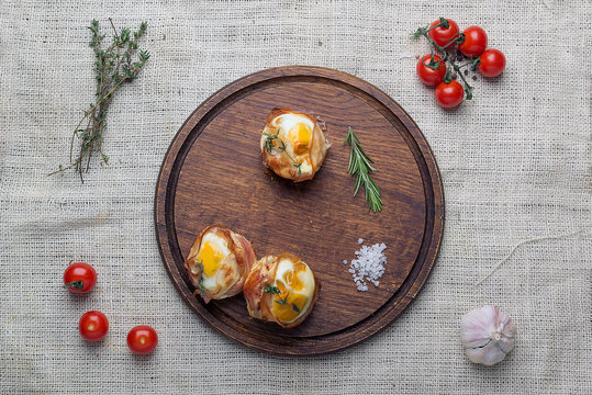 meat caces with eggs on the wooden tray