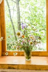 Homemade flowers. Still life on the windowsill.