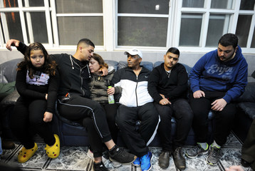 The immediate family of Israeli soldier Netanel Kahalani mourn in their home before Netanel's funeral in the town of Elyakim