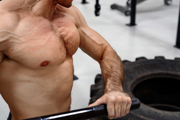 Man with a sledge hammer and tyre. Fitness
