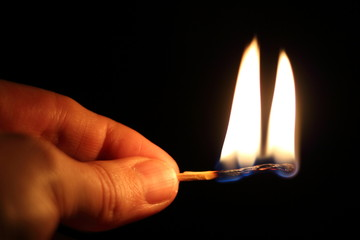Burning matchstick in the hand