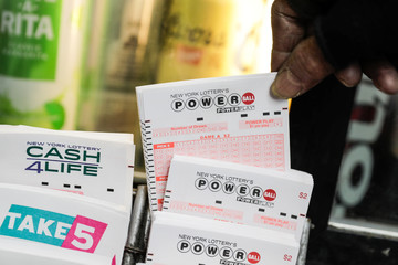 Customer buys tickets for the Powerball lottery in New York City