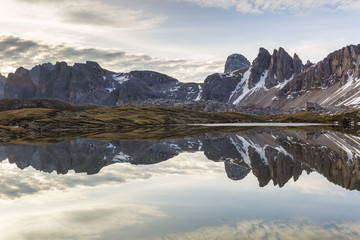 Rocky peaks reflected in Laghi Dei Piani, Dolomites, South Tyrol, province of Bolzano, Italy..