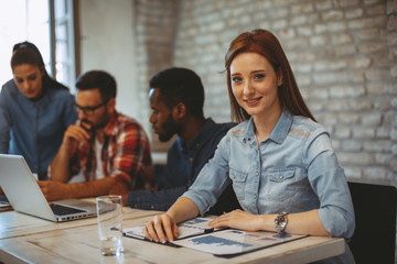 Young business woman posing at a meeting