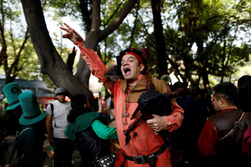 A member of a bagpipe band gestures during the St Patrick's Day parade in Mexico City