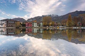 Pescarenico and Resegone mount reflected in the river Adda, Lecco, Lecco province, Lombardy, Italy