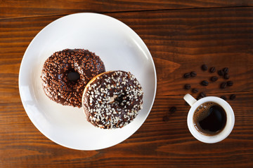 sugar glazed donuts with mug coffee