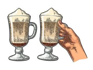 Glass of Latte macchiato coffee with whipped cream.